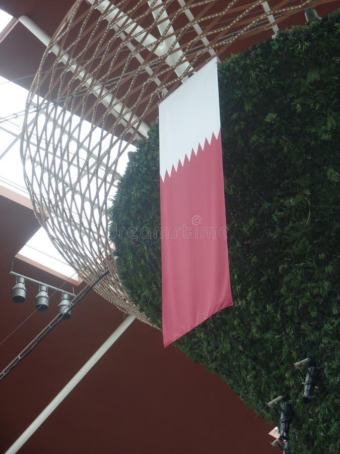 Qatari flag hanging from a display stock photos