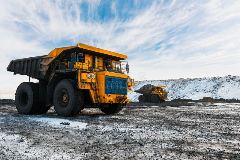 Large quarry dump truck. Loading the rock in dumper. Loading coal into body truck. Production useful minerals. Mining. Large quarry dump truck. Loading the rock royalty free stock photo