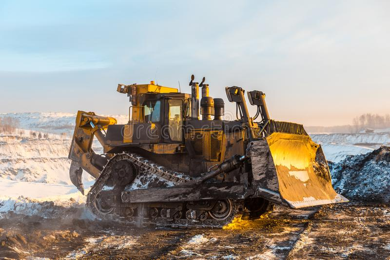Large quarry dump truck. Loading the rock in dumper. Loading coal into body truck. Production useful minerals. Mining. Large quarry dump truck. Loading the rock royalty free stock image