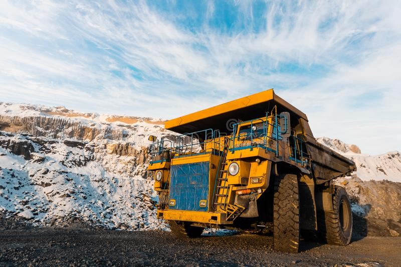 Large quarry dump truck. Loading the rock in dumper. Loading coal into body truck. Production useful minerals. Mining. Large quarry dump truck. Loading the rock stock image
