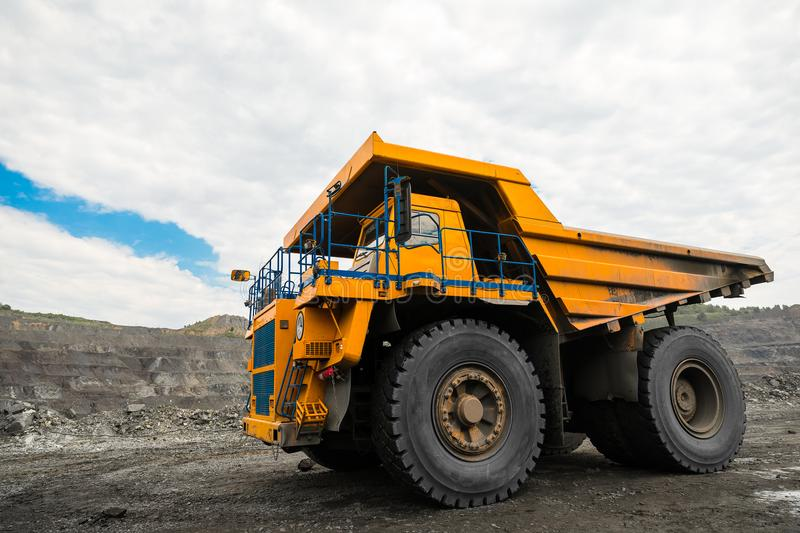 Large quarry dump truck. Loading the rock in dumper. Loading coal into body truck. Production useful minerals. Mining royalty free stock photos