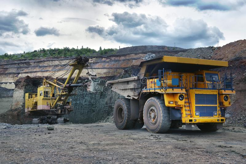 Large quarry dump truck. Loading the rock in the dumper. Loading. Coal into body work truck. Mining truck mining machinery, to transport coal from open-pit stock images
