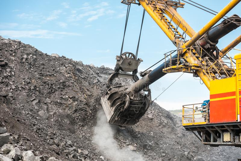 Large quarry dump truck. Loading the rock in dumper. Loading coal into body truck. Production useful minerals. Mining. Large quarry dump truck. Loading the rock stock images