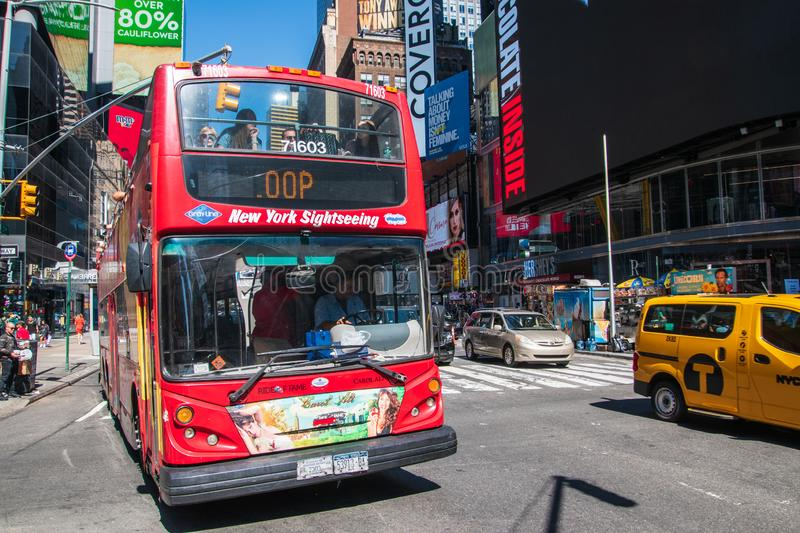 Large red double decker sightseeing tour bus full of tourists seen on Broadway in Times Square Manhattan, New York City stock image