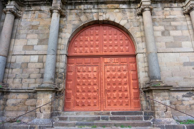 Large red european doorway church entrance in Rennes France royalty free stock photos