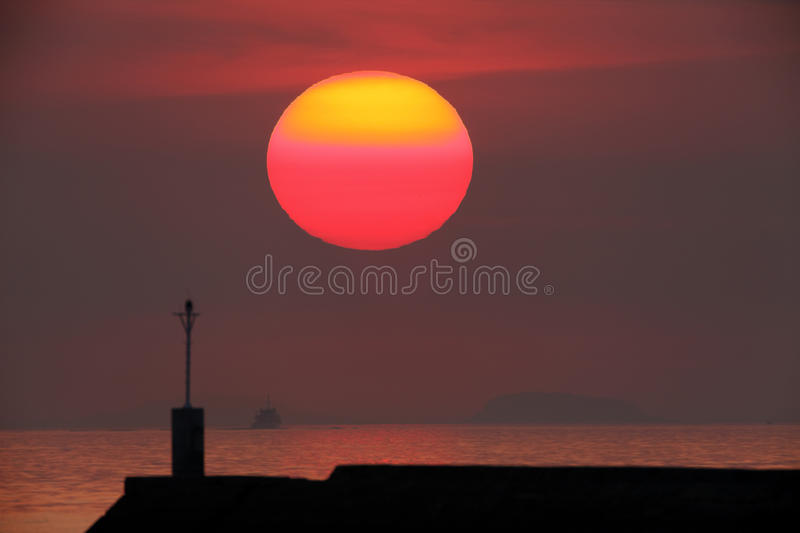 Download Large red sun stock image. Image of landscape, breakwater - 18774061