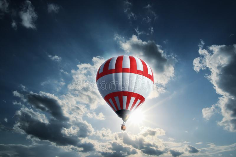 Large red-white balloon illuminated by the sun royalty free stock photo