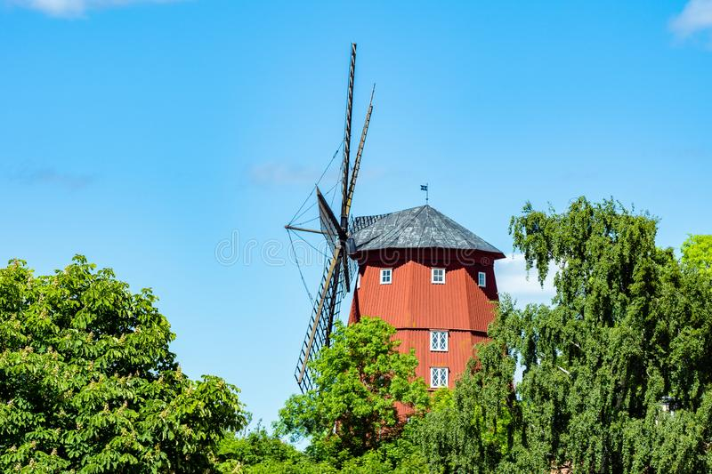 Large red wooden windmill in Sweden stock image