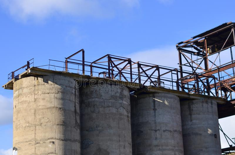Large reinforced concrete pipe construction with a metal ladder against stock images