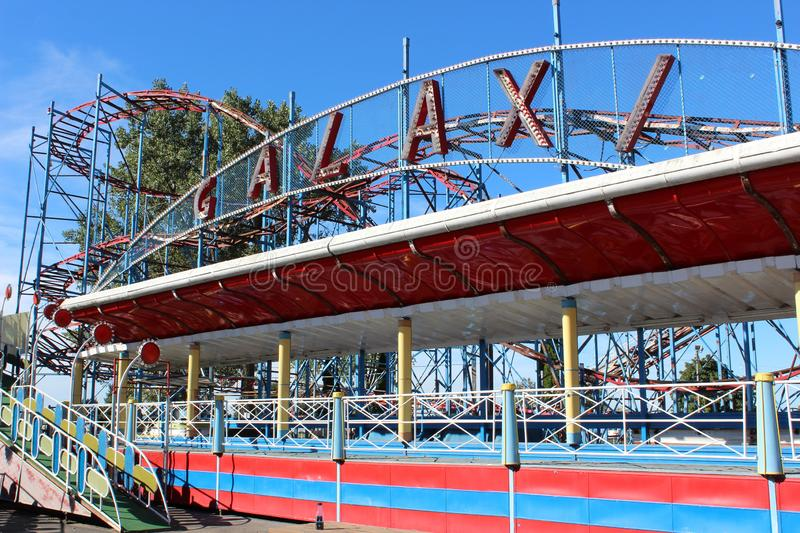 Bright blue skies overhead with rides ready for visitors, Sylvan Beach Amusement Park, New York, 2018. Large ride known as `Galaxy` ready to entertain visitors royalty free stock photos