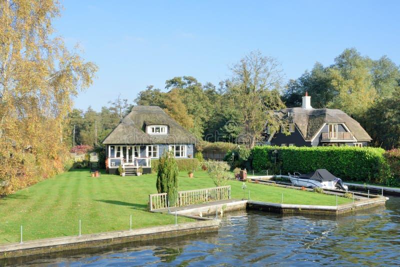 Large Riverside home on River Yare. Wroxham Norfolk , United Kingdom - October 25, 2016: Large Riverside home on River Yare stock photography