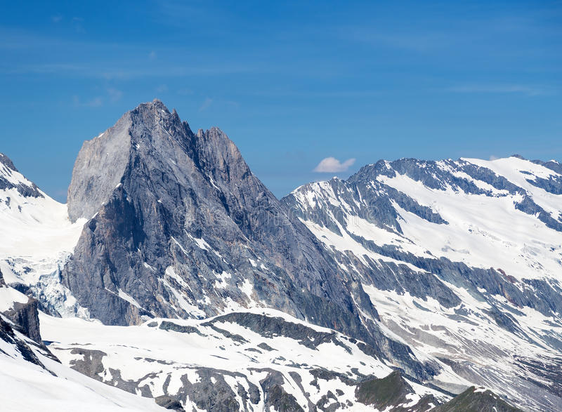 Large rock. A large rock on the Grande Motte glacier in French Alps stock photo