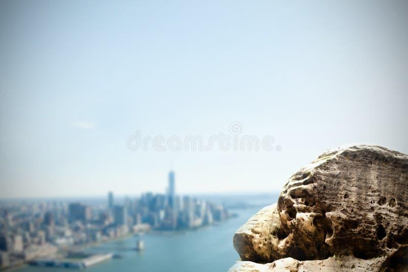 Large rock overlooking coastline city stock illustration