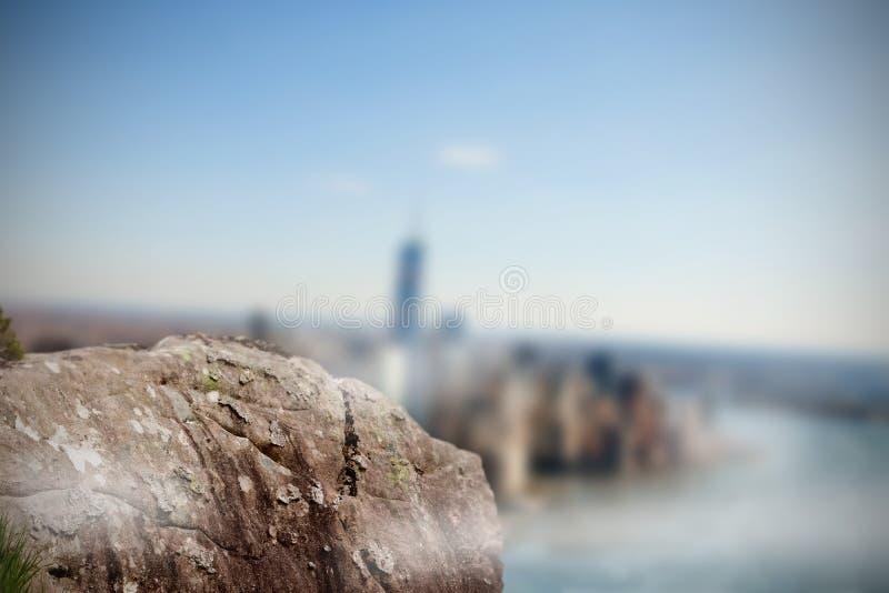 Large rock overlooking foggy city stock illustration
