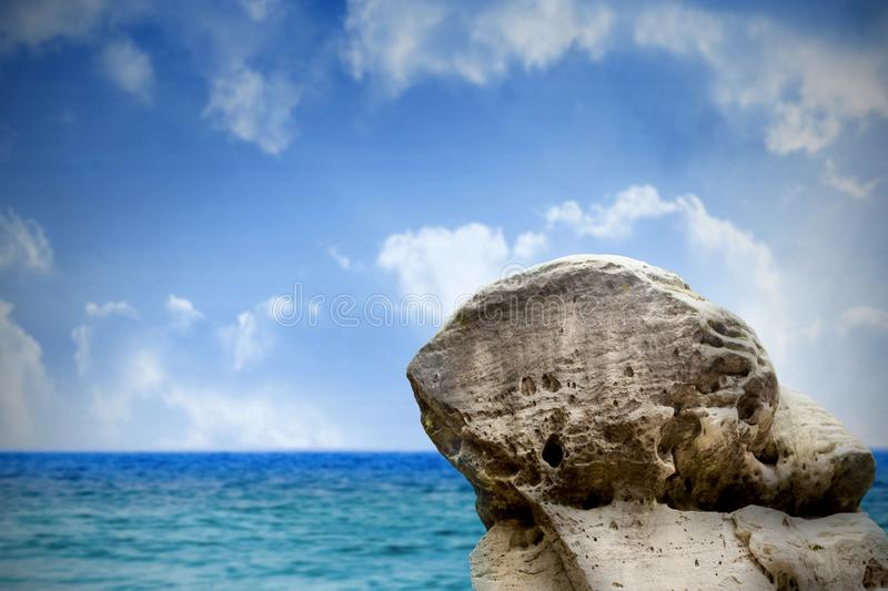 Large rock overlooking sea and sky royalty free illustration