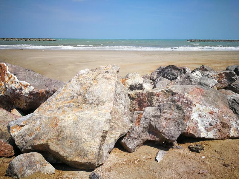 The large rock pile on the beach. Has to protect the shore stock photo