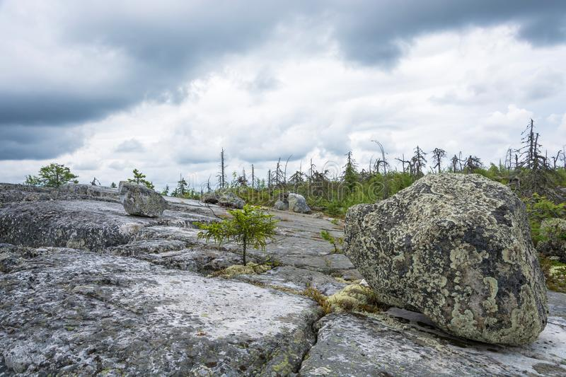 Large rocks boulders in the nature reserve of mount Vottovaara,. Large stones boulders in the nature reserve of mount Vottovaara, Karelia, Russia royalty free stock image