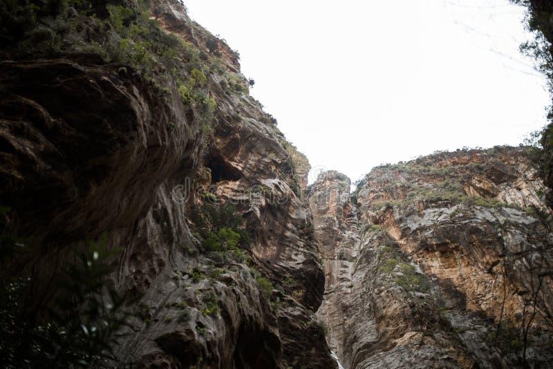 Large rocks hang from below. At summer royalty free stock photography