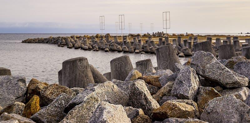 Breakwater Rocks Near Marina. Large Rocks protecting marina from storm surge royalty free stock image
