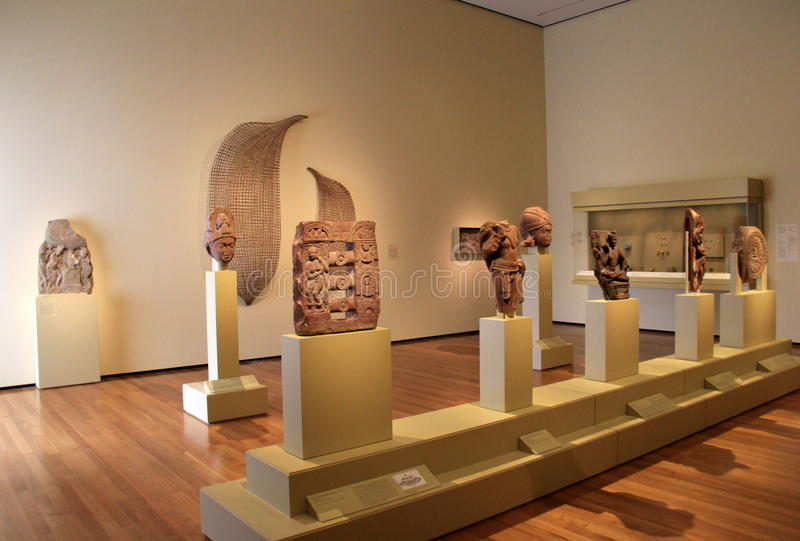 Large room with Egyptian artifacts set on pedestals, Cleveland Art Museum, Ohio, 2016 stock image