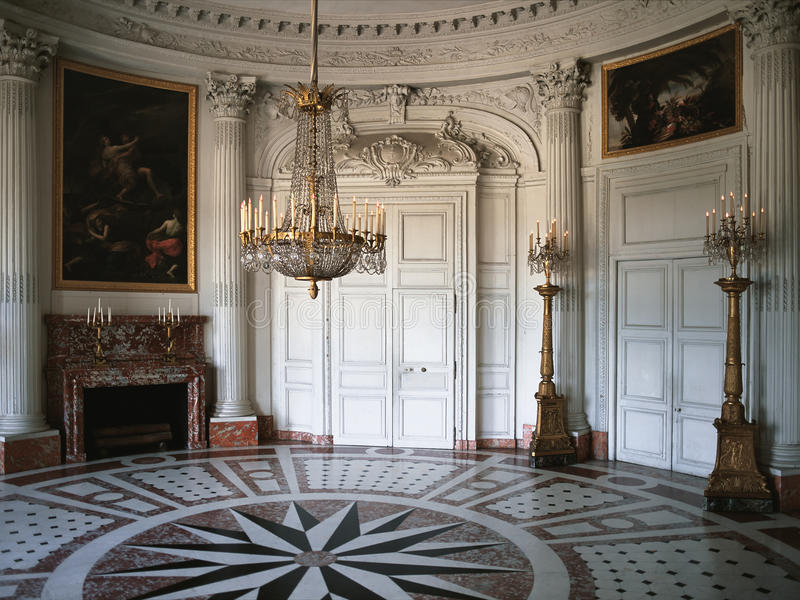 Large room with wooden wall and paintings at Versailles Palace royalty free stock image