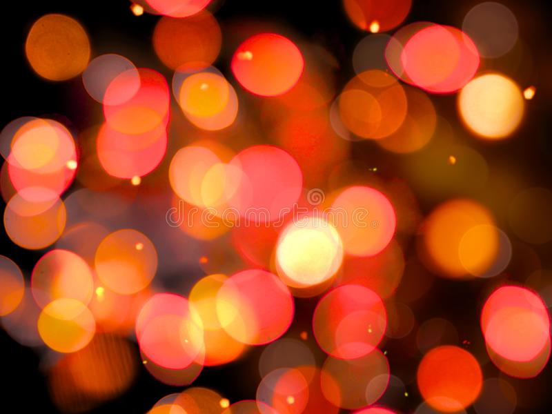Large round blurred overlapping glowing lights with sparkle effect on a black background. A large round blurred overlapping glowing lights with sparkle effect on royalty free stock image