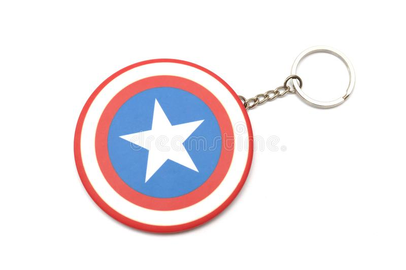 A large round keychain with Marvel`s Captain America shield logo. A photo taken on a large round keychain with Marvel`s Captain America shield logo against a royalty free stock photos