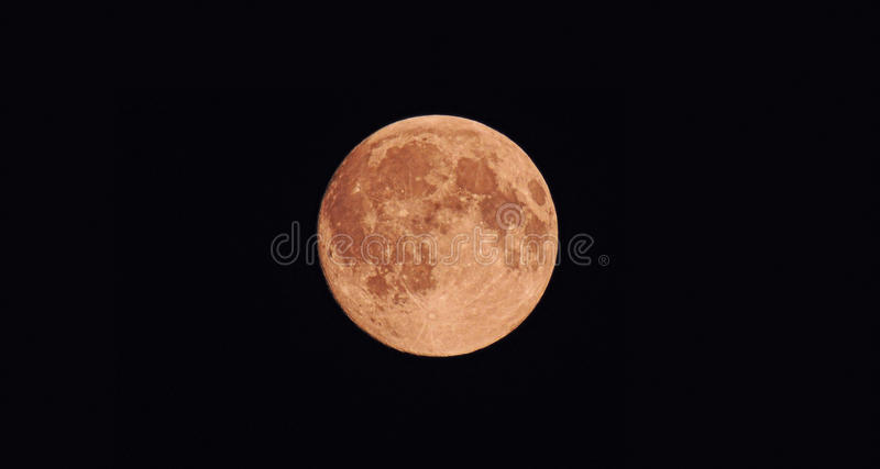 A Large round moon in the dark sky stock image