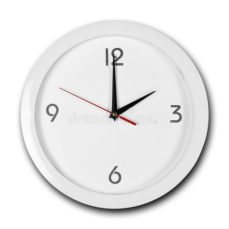 Free Large Round White Wall Clock With White Frame. The Hands Point To 2 O`clock. Close Up. Isolated On White Background Stock Photo - 155696780