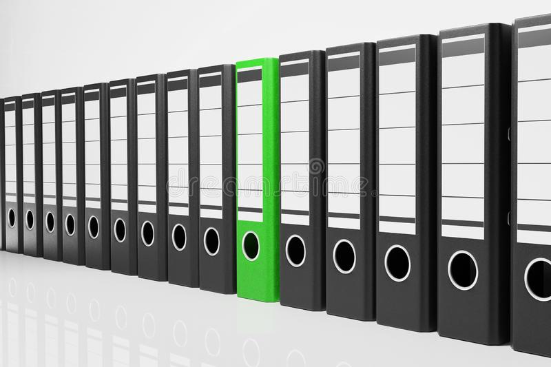 Large row of black office folders with one green binder, conceptual archive 3D Illustration vector illustration