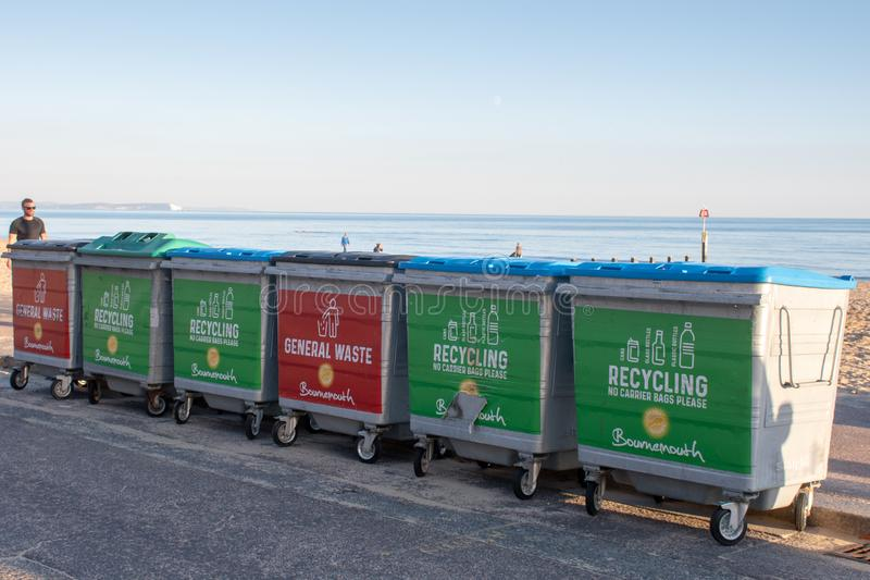 Large row of council waste recycling bins stock images