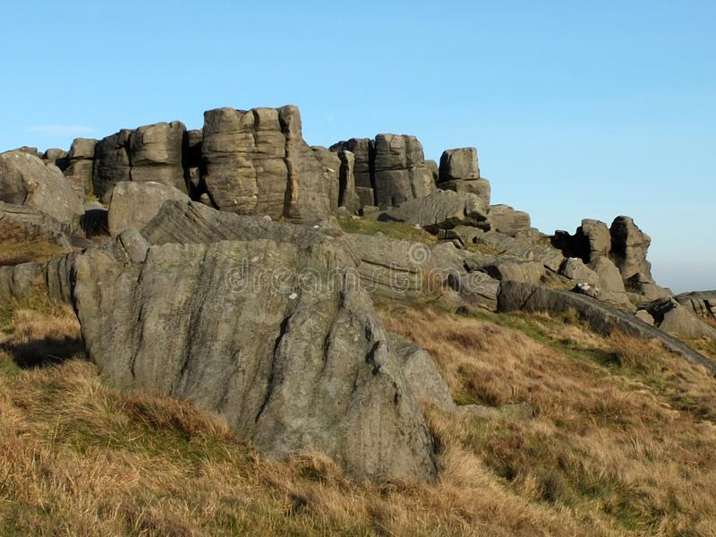 Large rugged gritstone outcrop at the bridestones a large rock formation in west yorkshire near todmordenwith blue sky and. A large rugged gritstone outcrop at stock image