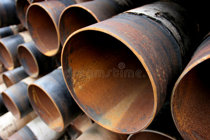 Large rusting steel pipes stock photos