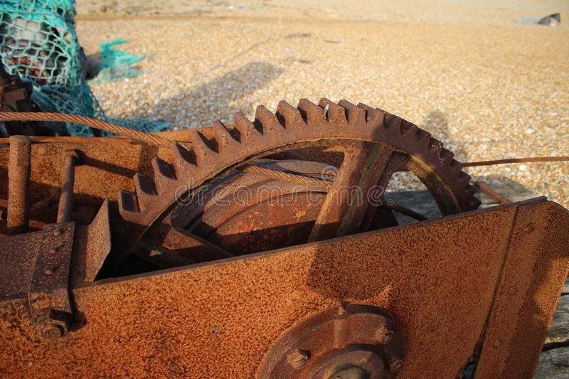 Large Rusty Cog. Found on dungeoness Beach.Next to fishing Nets. On pebbled dessert stock photography