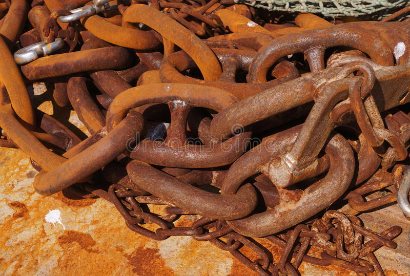 Large Rusty Metal Chains. Close up of several large rusty metal chains in an untidy tangled pile royalty free stock photos