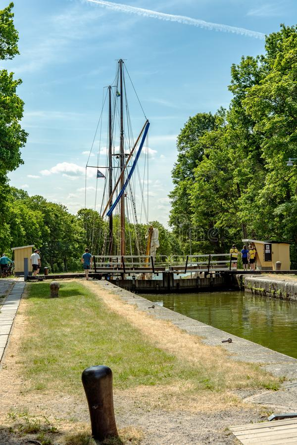 Large sailboat entering a canal lock at Gota canal stock images