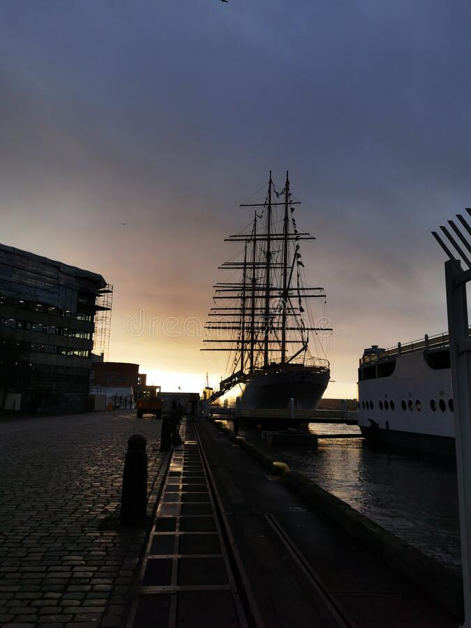 Large sailing ship in Sweden before a beautiful sunset on the horizon stock photos