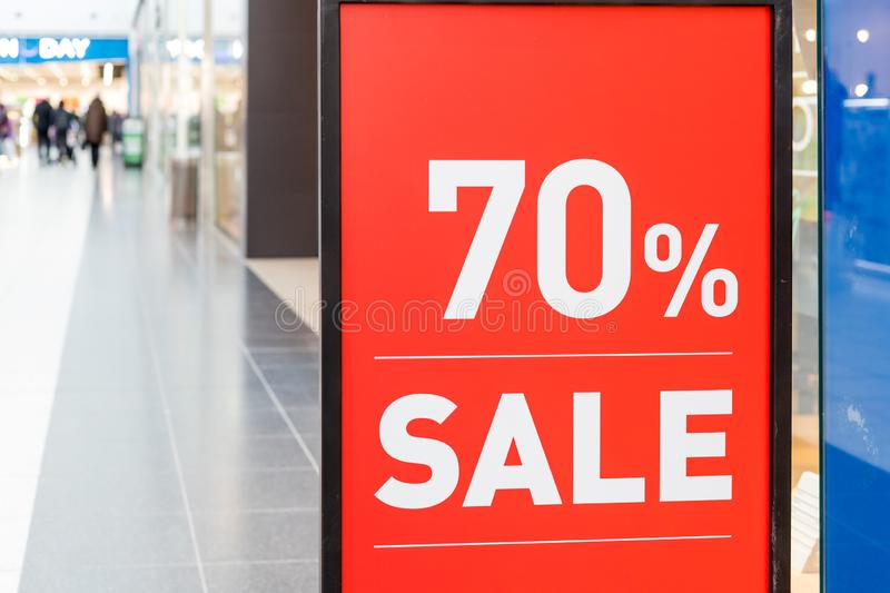 Large Sale 70 off letters on shopping mall wall pillar, bokeh shopping mall as background.Final sale.shopping, business royalty free stock images