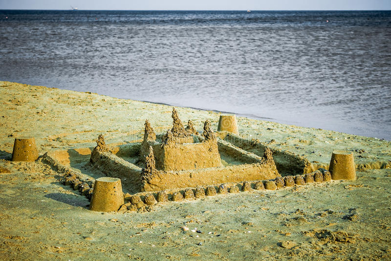 A large sand castle built by children's hands royalty free stock image