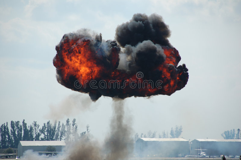 Large scale mushroom explosion. Explosion with fire and black smoke stock photography