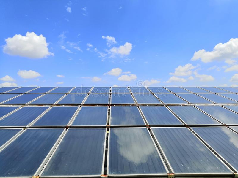 Large-scale.Solar water heating system on the hospital roof. royalty free stock images
