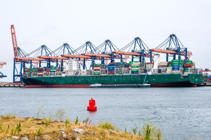 Large sea container ship in a container terminal in the port of Rotterdam royalty free stock images