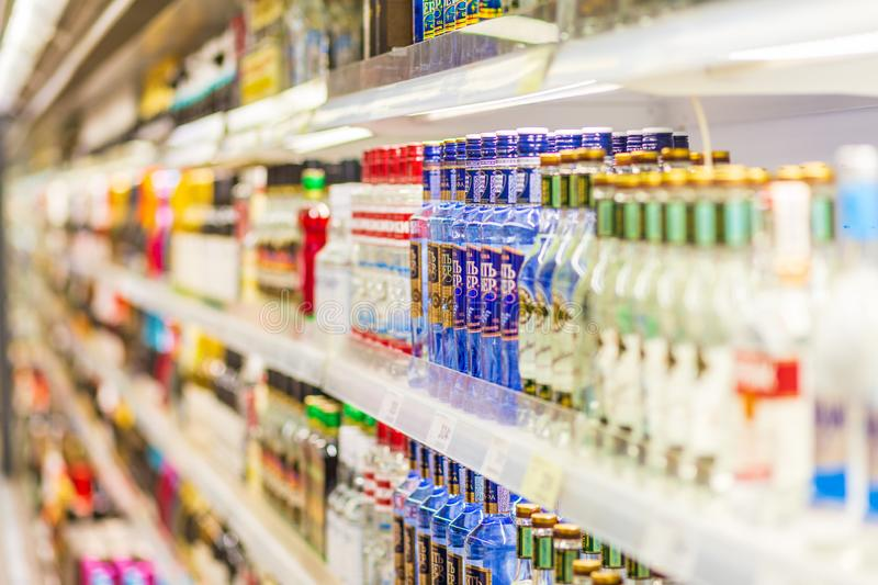 A large selection of alcoholic beverages on the shelves of a supermarket. Russia, Samara, May 2019: a large selection of alcoholic beverages on the shelves of a royalty free stock photos