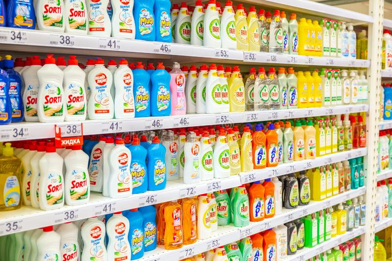 a large selection of cleaning products on the shelves of the store. stock images