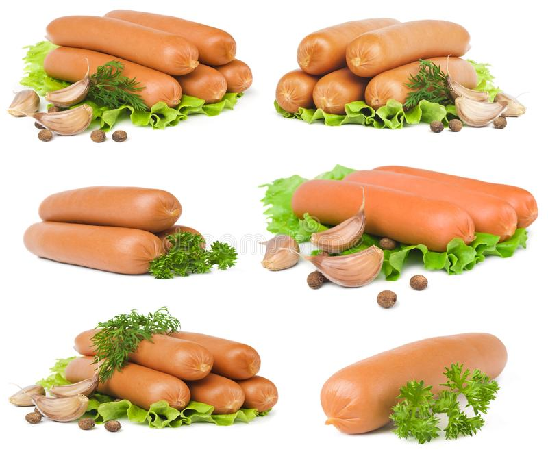 Large selection of sausages with spices close-up on a white background stock image