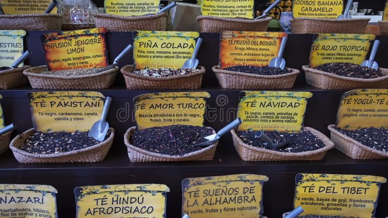 Large selection of various flavored tea leaves in jute baskets and no individual packaging royalty free stock photography
