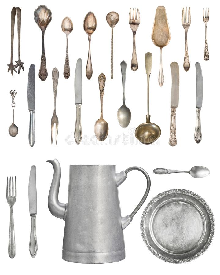 A large set of antiques isolated on a white background. Old spoon, fork, knife, kettle, steamer.  royalty free stock image