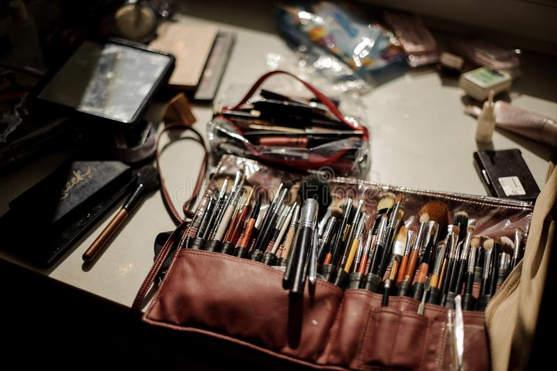 Large set of makeup cosmetics and brushes on the table royalty free stock images