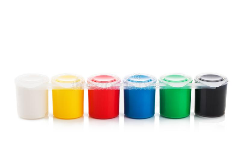 Large set of gouache paint cans in a row. Colorful paints isolated on white royalty free stock photos