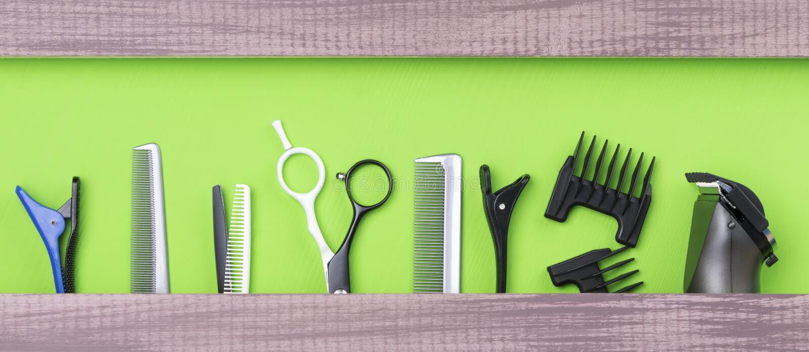 Large set of hair stylist for cutting hair on a green background royalty free stock image
